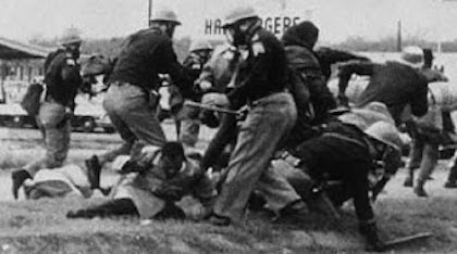 alabama_state_troopers_attack_john_lewis_at_the_edmund_pettus_bridge__public_domain_